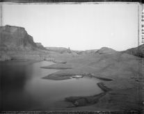 Campsite reached by boat through watery canyons, Lake Powell, 8/20/83 (1983) by Mark Klett