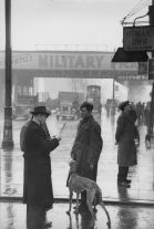 Untitled (men in street with greyhound) (1940s) by Bert Hardy