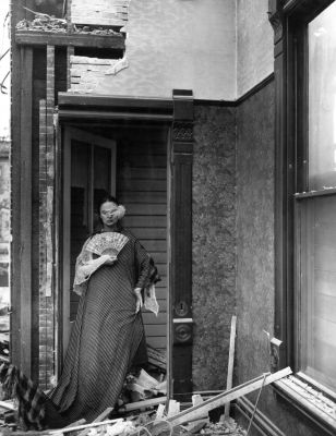from Closet of the Past (Woman with fan and feather) (1957) by Clarence John Laughlin