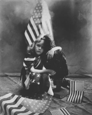 Girl with Flags and Eagle (ca. 1910) by Louis Fleckenstein