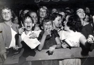 Untitled (kids waiting for autographs) (1940s) by (Arthur Fellig) Weegee