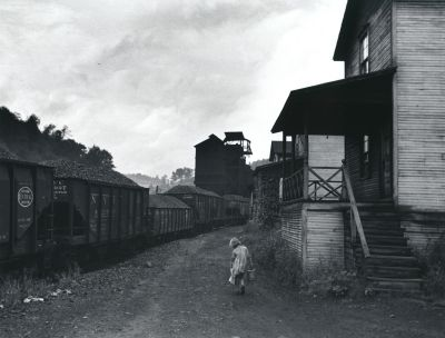 Coal miner's daughter... carrying kerosene..., Scott's Run, West Virginia (1938) by Marion Post Wolcott