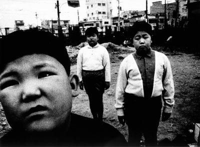 "Children Who are Too Grownup from ""The Island with 100 Million People 48"" (three boys) (1968) by Daido Moriyama"