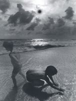 Untitled (child on beach) (1975) by Jerry Uelsmann