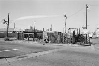 From Angel City West (junkyard and downtown scene) (1983) by Mark Steinmetz