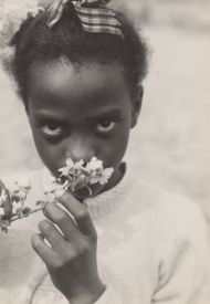[Child with Apple Blossoms] (Tennessee) (1948) by Consuelo Kanaga