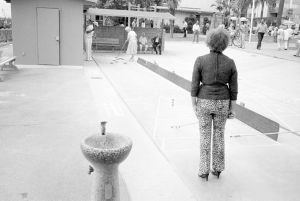 From Angel City West (shuffleboard woman) (1983) by Mark Steinmetz