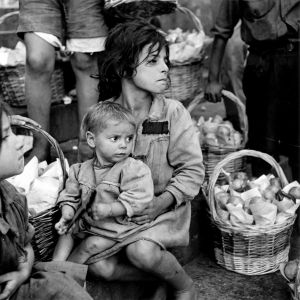 Naples, Italy (girl holding toddler) (1944) by Wayne Miller