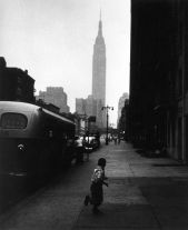 Boy and Empire State Building, NYC (1951) by George S. Zimbel