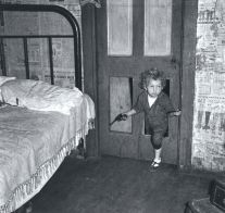 Untitled (kid walking through door with gun) (c. 1940) by Marion Post Wolcott