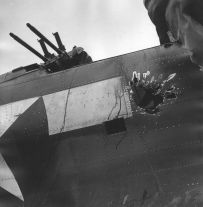Pacific Theater, WWII (bullet holes in side of plane) (1942-45) by Wayne Miller