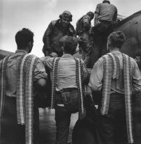 Pacific Theater, WWII (men carrying ammunition) (1942-45) by Wayne Miller