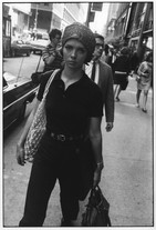 New York (Woman with Bandana Walking on Sidewalk) (1968) by Garry Winogrand