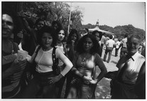 Untitled (Central Park, Gazebo, Woman at Center of Crowd) (1972) by Garry Winogrand