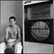 Young convict about to discharge a ten-year sentence. Apparatus to open cells. (1967-1968) by Danny Lyon