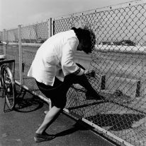 From Tokyokei (Woman passing the wire netting) (1970s-1980s) by Issei Suda