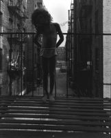 Untitled, from East 100th St. (child on fire escape) (1968) by Bruce Davidson