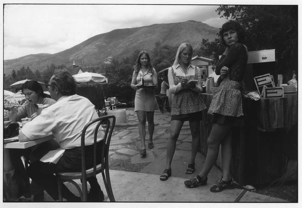 Untitled (Waitress at Outdoor Restaurant, Aspen, Colorado) (1971) by Garry Winogrand