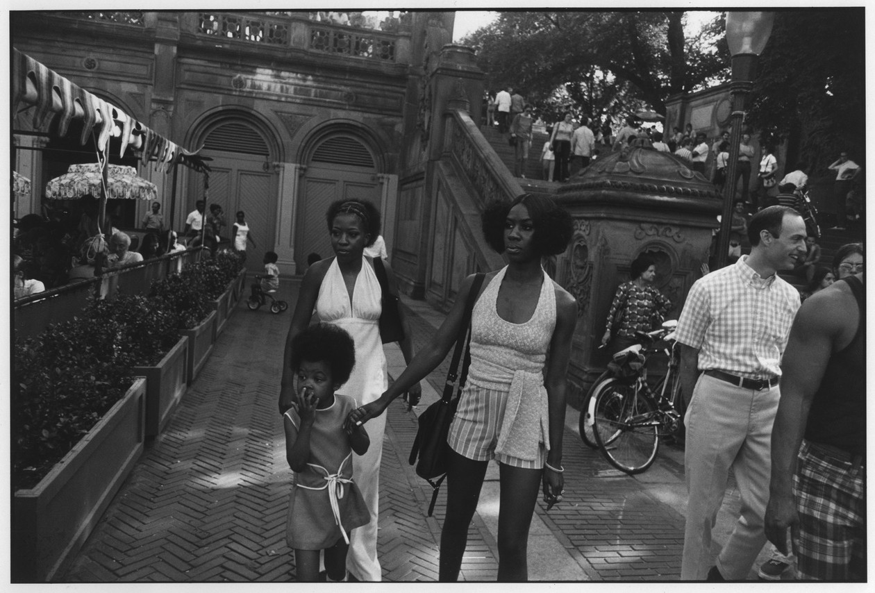 Untitled (Two African American Women and Child, Central Park) (1970) by Garry Winogrand