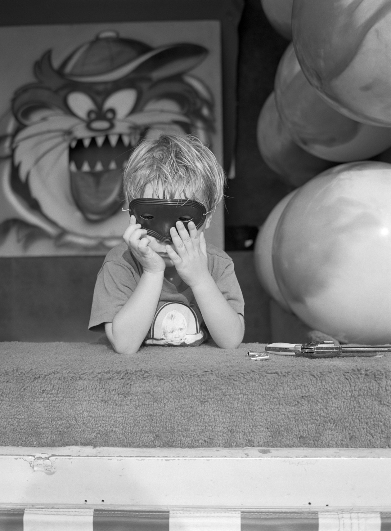 Untitled (masked boy), from Carnival (1995) by Mark Steinmetz