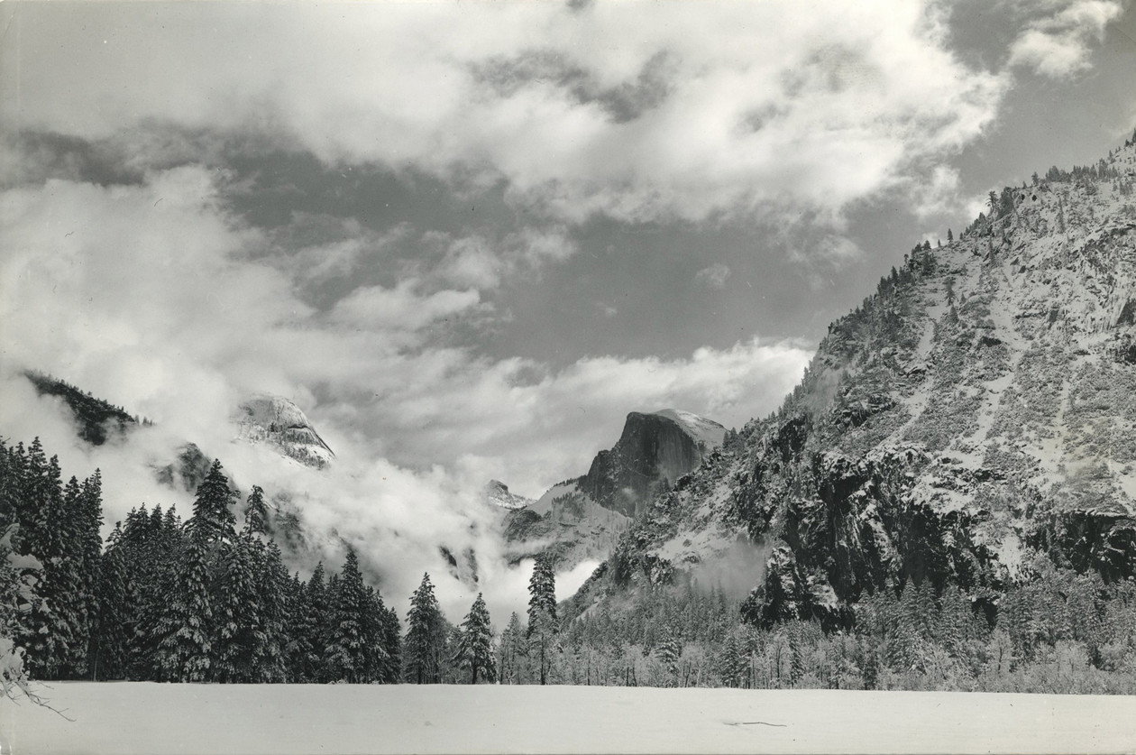 Half Dome and North Dome in clouds, Yosemite Valley (ca. 1940s) by Ansel Adams