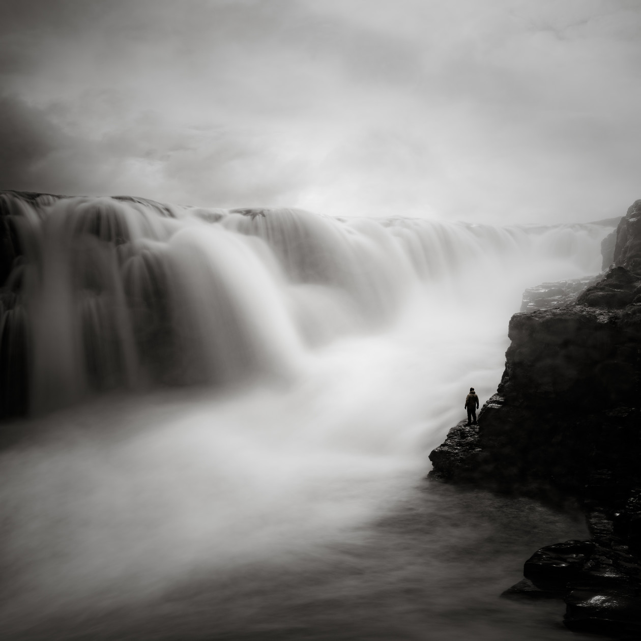 Figure and Waterfall, Iceland (2018) by Jeffrey Conley