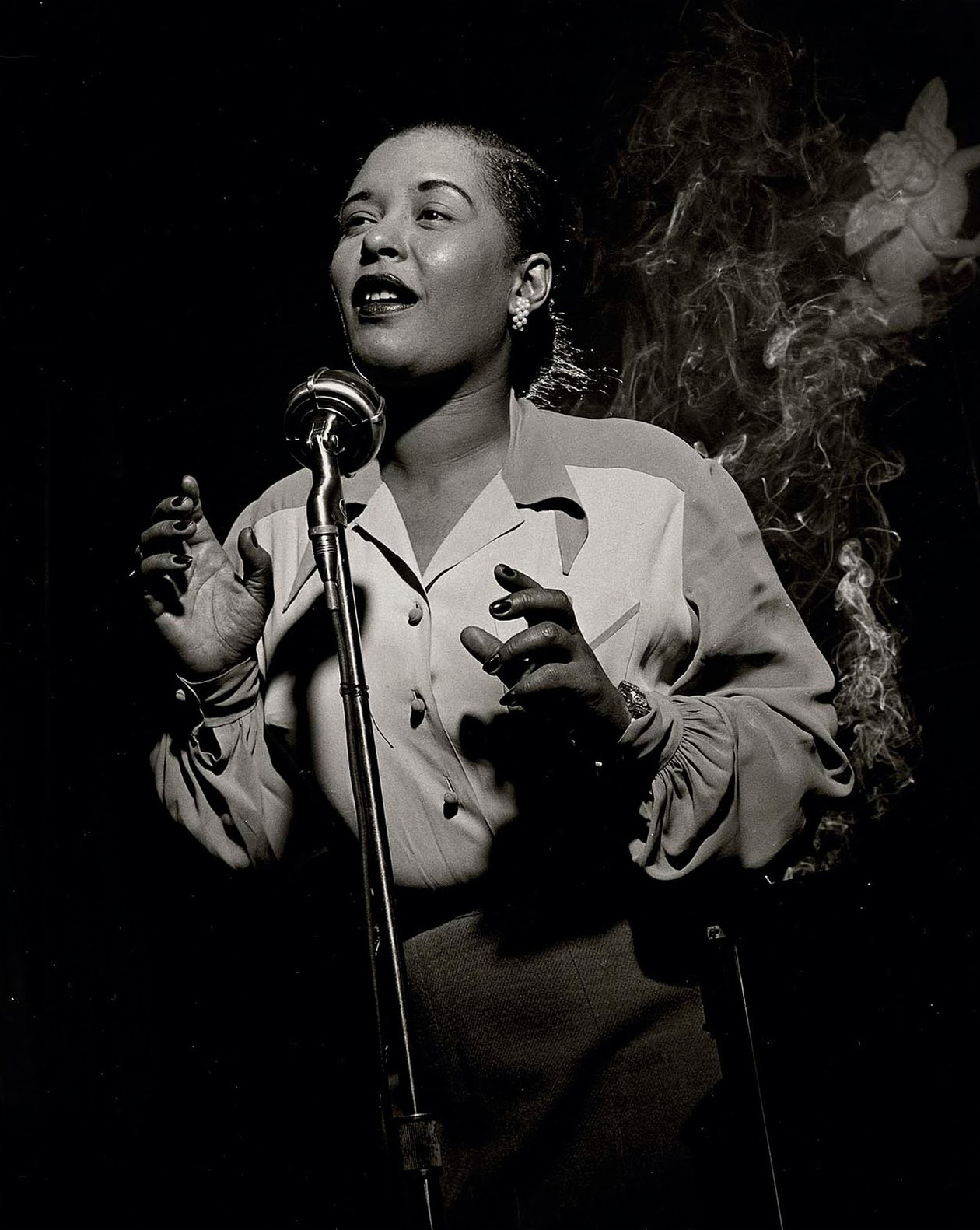 Billie Holiday, NYC [Angel with Smoke] (1949) by Herman Leonard