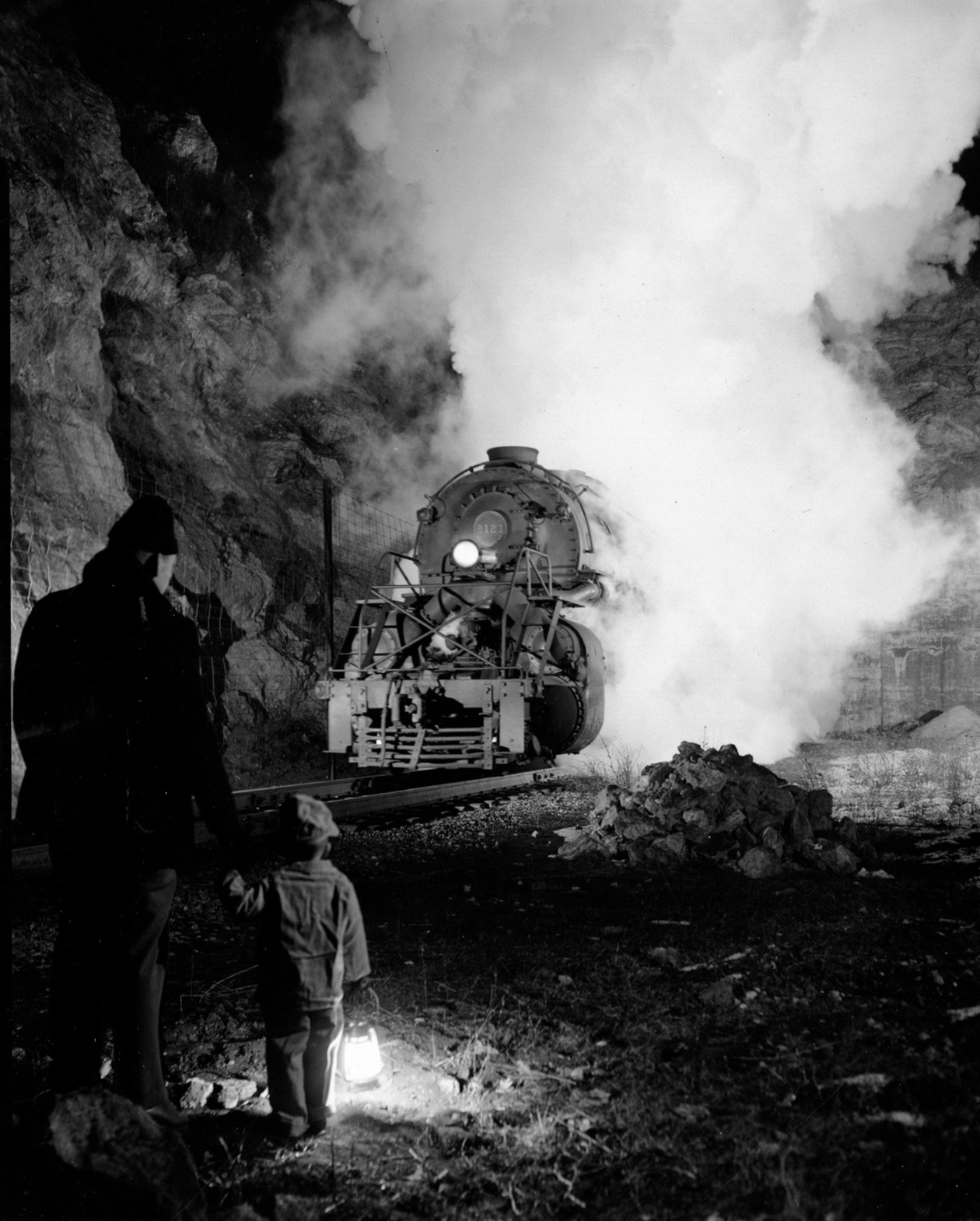 Untitled (man and child watching train) (1955) by O. Winston Link