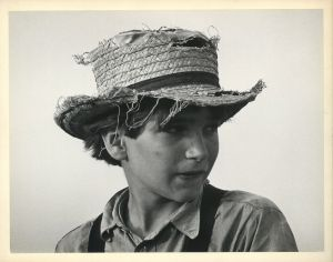 Old Order Amish Boy with Tattered Homemade Straw Hat (1965) by George Tice