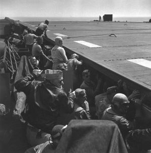 Pacific Theater, WWII (aircraft carrier, men waitiing) (1942-45) by Wayne Miller