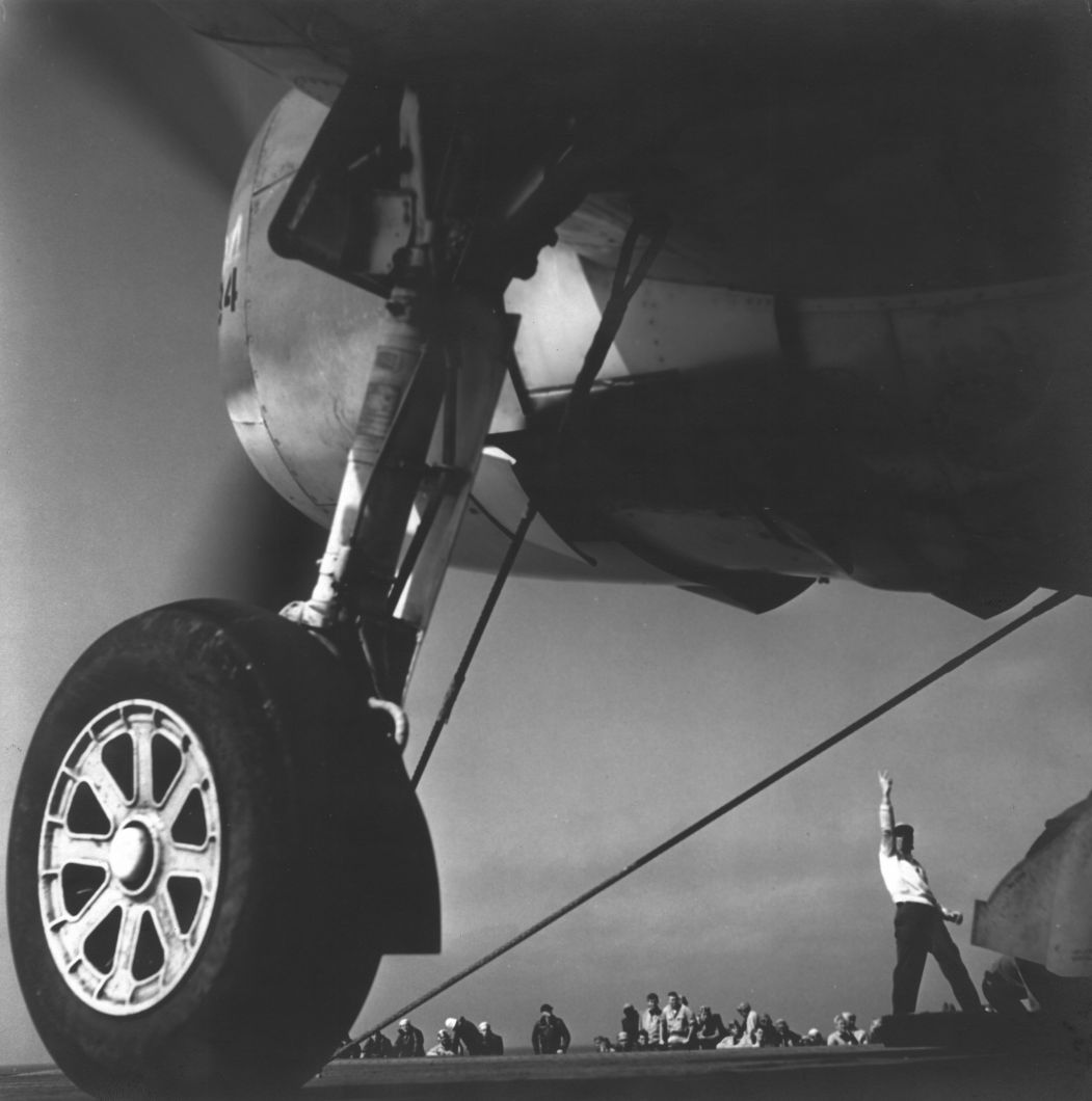 Pacific Theater, WWII (plane being signaled into position for take off) (1942-45) by Wayne Miller