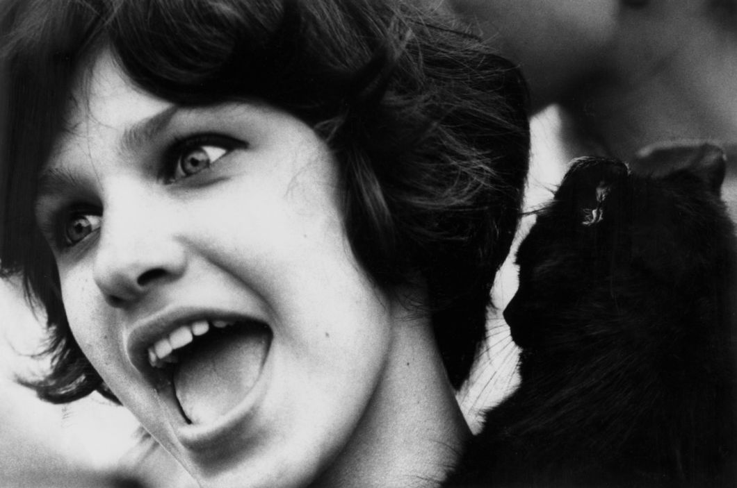 Washington Square, New York City (girl's face with cat) (1961) by Dave Heath