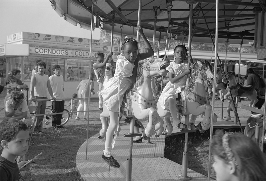 Untitled (merry go round girls), from Carnival (1991) by Mark Steinmetz