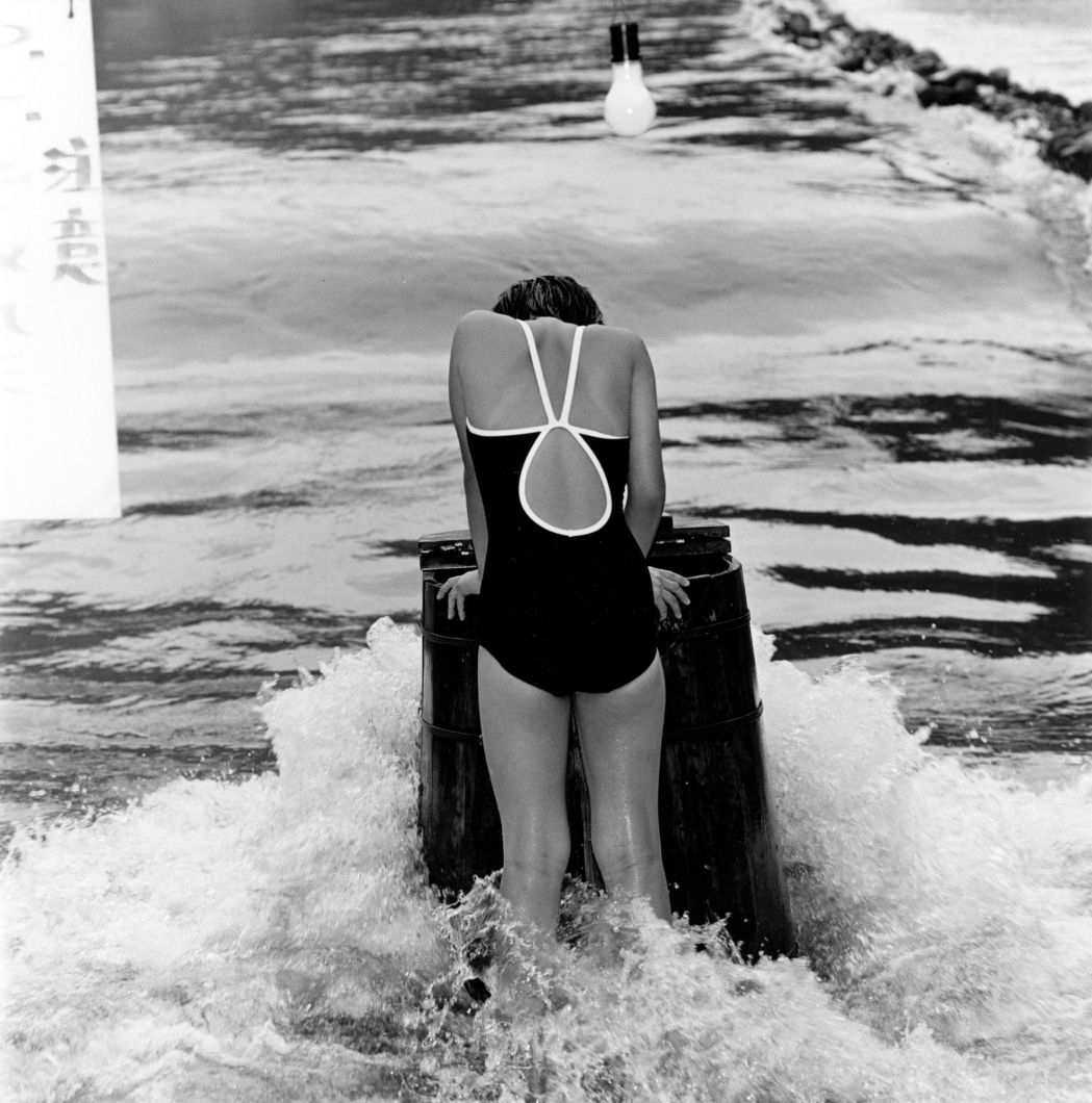 Untitled (Girl in the water, lightbulb) (Late 1970s - 1981) by Issei Suda