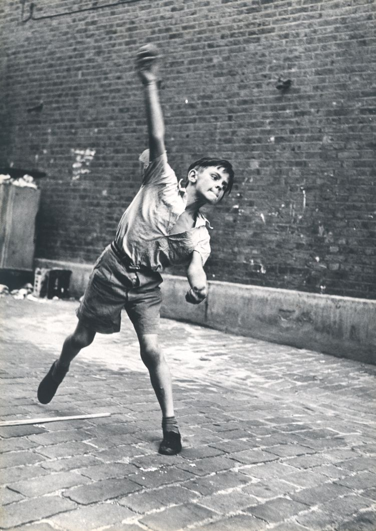Bowler, Street Cricket, Addison Place (1957) by Roger Mayne