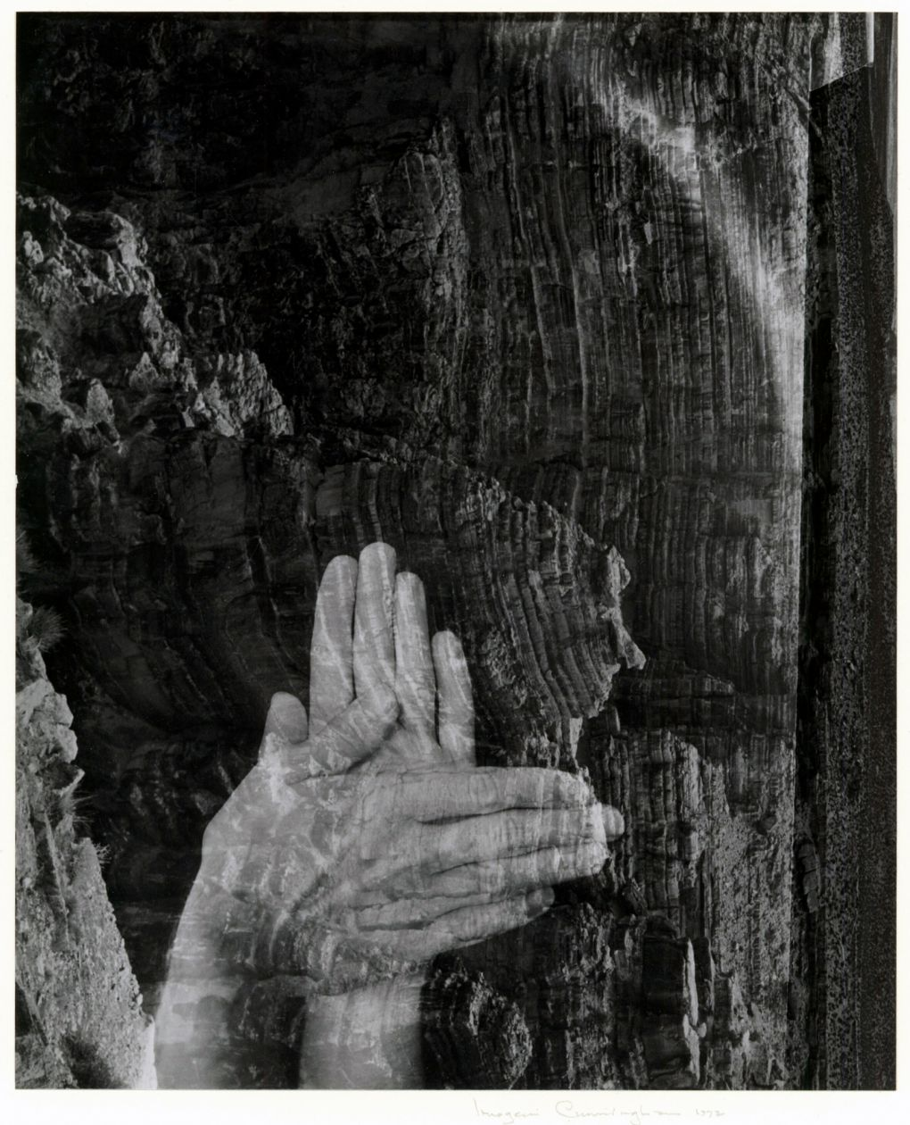 Self Portrait (hands in front of cliffs) (1972) by Imogen Cunningham