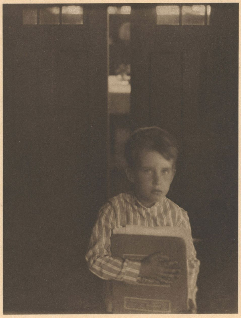Boy with Camera Work (c. 1905) by Clarence White