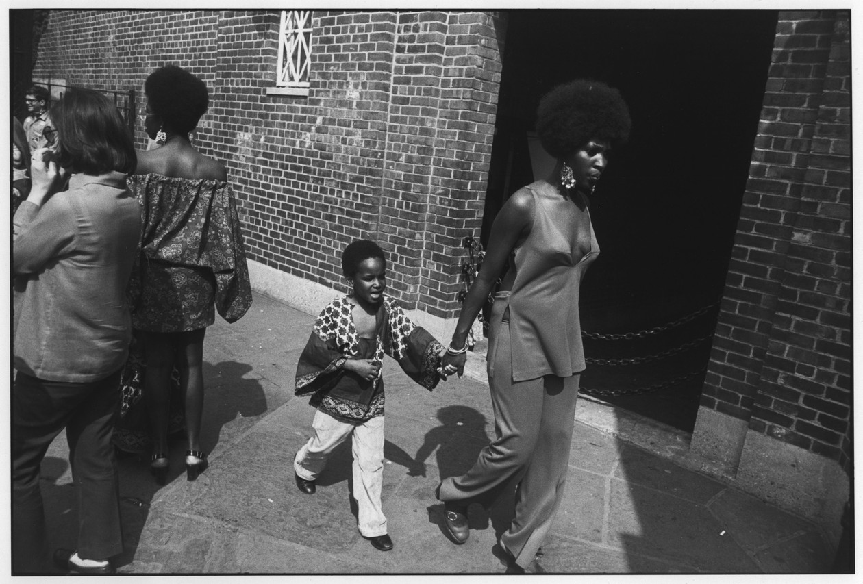 Untitled (Woman with Afro, Young Boy) (1965) by Garry Winogrand