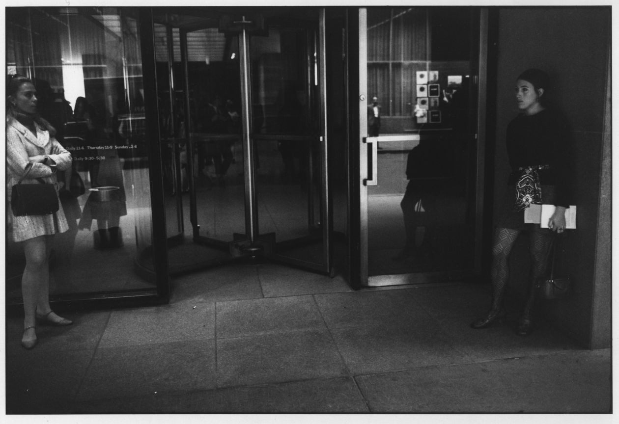 Untitled (Two Women on Either Side of Revolving Door) (1971) by Garry Winogrand