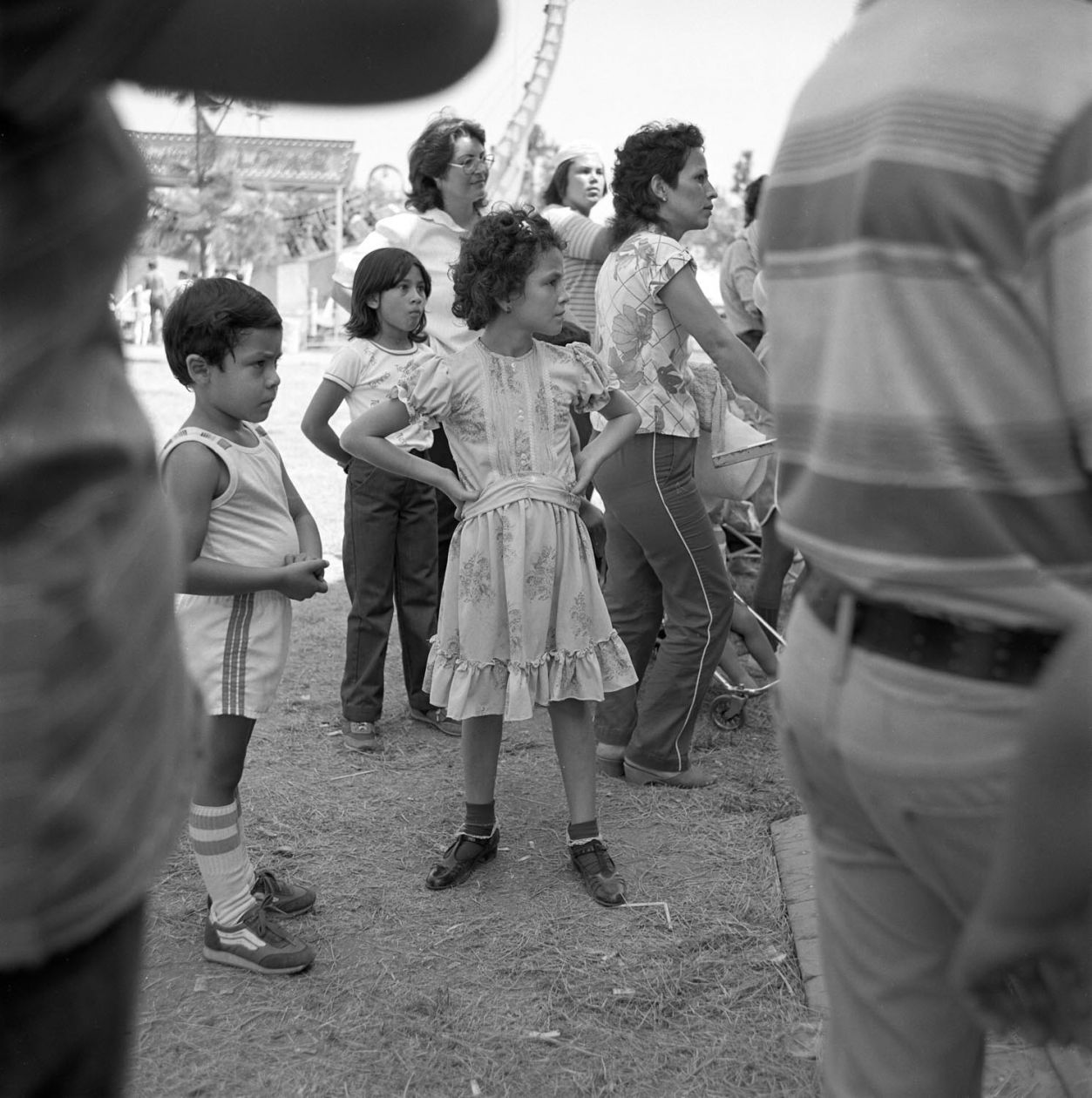 From Angel City West (girl in dress) (1983) by Mark Steinmetz