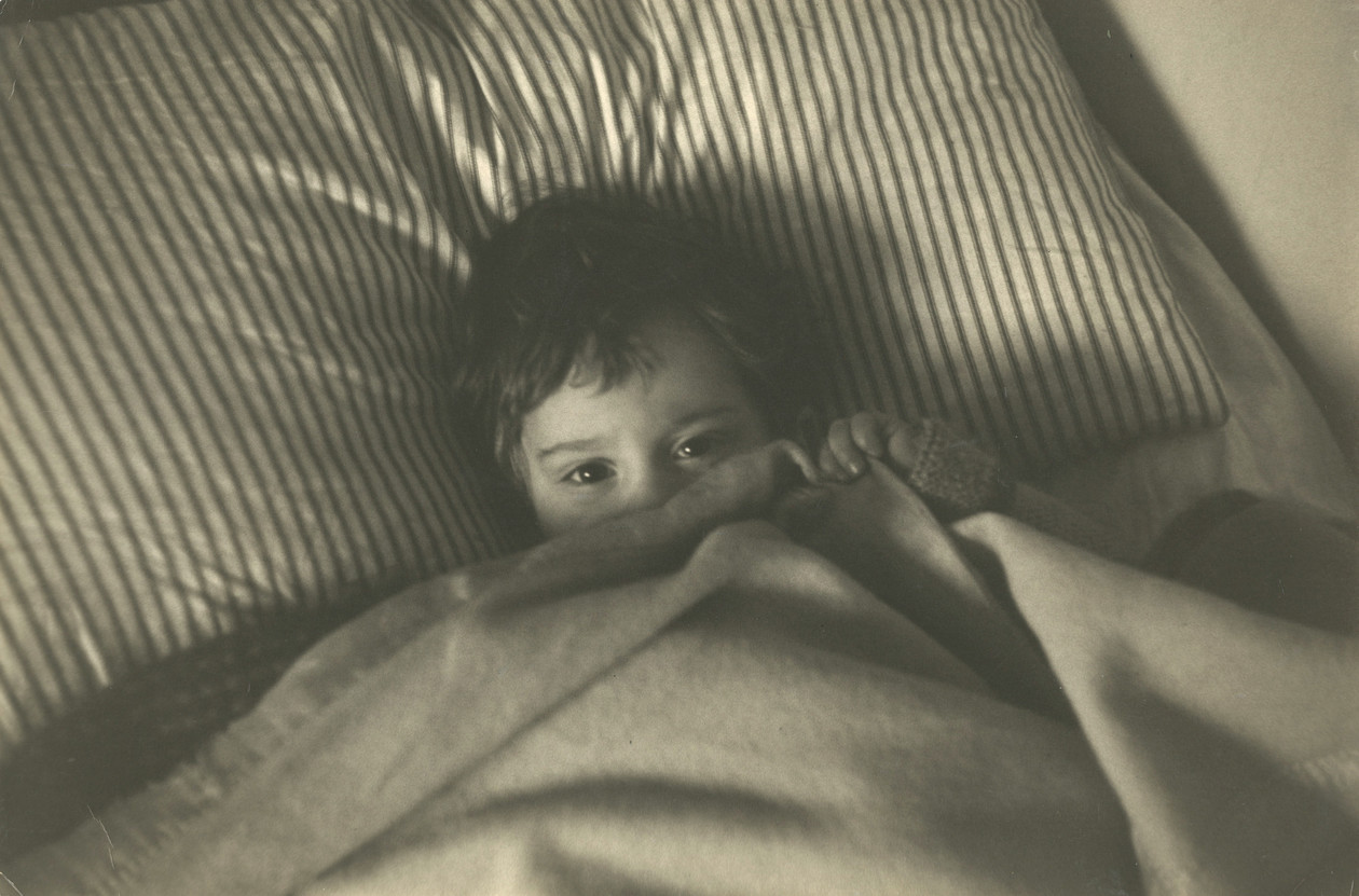 Untitled (Pablo under covers) (1950s) by Robert Frank